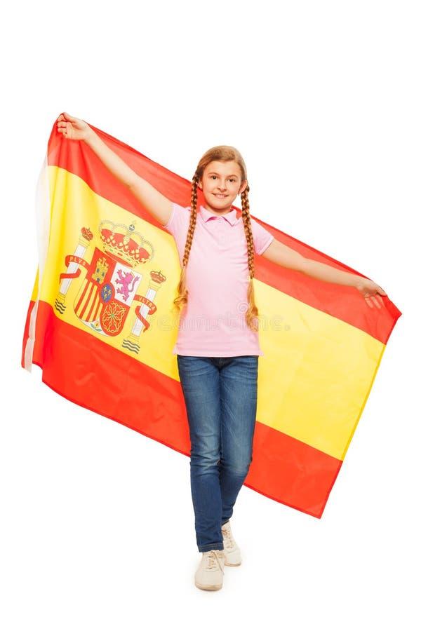 Bandera revelada tenencia de la chica joven detrás de ella detrás fotografía de archivo