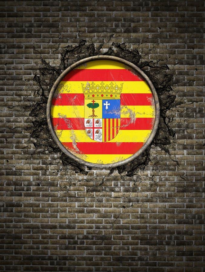 Bandera vieja de Aragón en pared de ladrillo foto de archivo libre de regalías