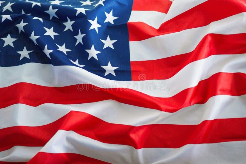 Bandera voluminosa brillante de los Estados Unidos de Am?rica en cierre del D?a de la Independencia para arriba fotos de archivo libres de regalías