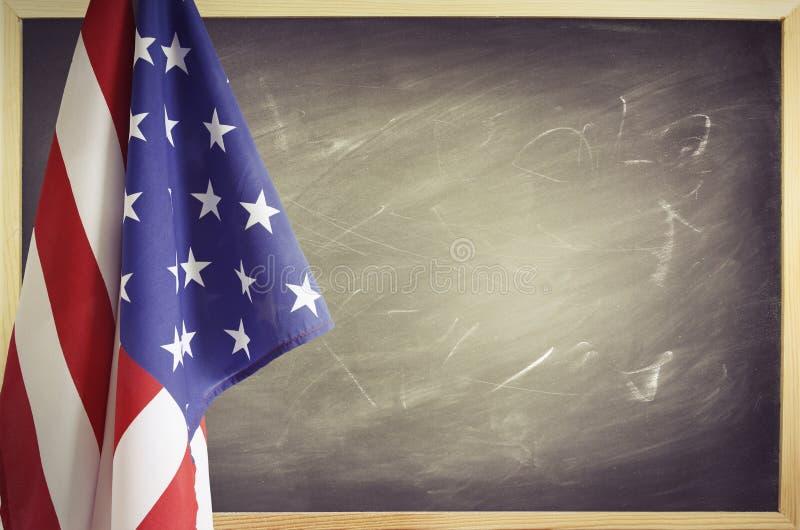 Bandera y pizarra imagen de archivo libre de regalías