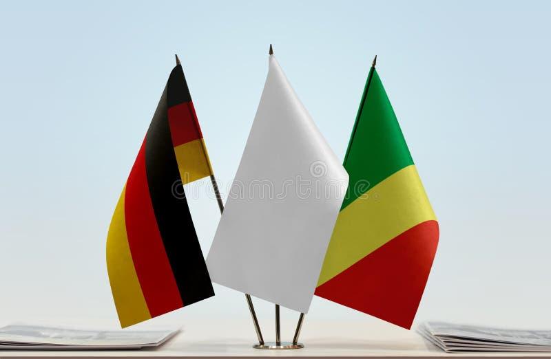 Banderas de Alemania y del República del Congo fotos de archivo