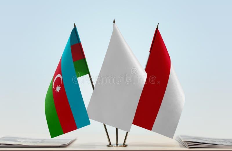 Banderas de Azerbaijan y de Mónaco fotos de archivo libres de regalías