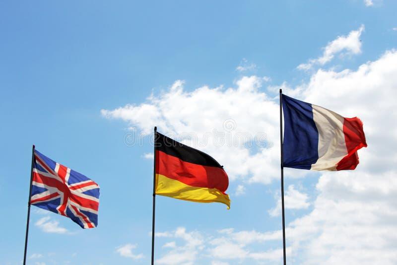 Banderas de Gran Bretaña, de Alemania y de Francia imágenes de archivo libres de regalías