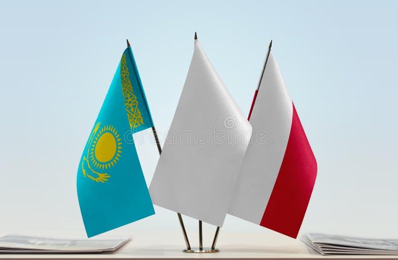 Banderas de Kazajistán y de Polonia fotos de archivo libres de regalías