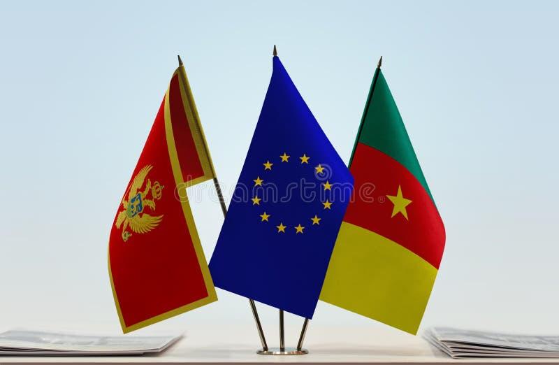 Banderas de la UE de Montenegro y del Camerún fotografía de archivo