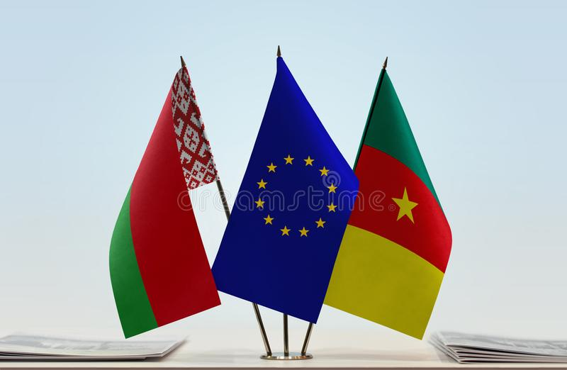 Banderas de la unión europea y del Camerún de Bielorrusia foto de archivo libre de regalías