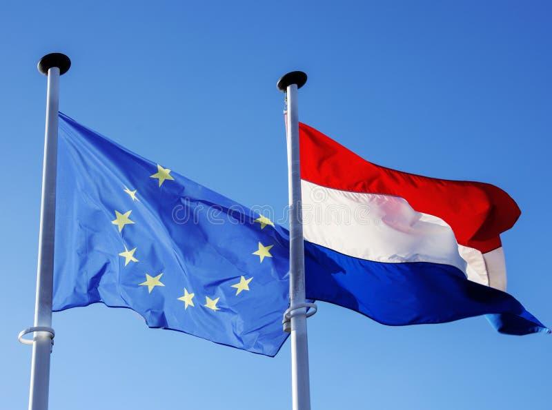 Banderas de la unión europea y de Luxemburgo imagen de archivo libre de regalías