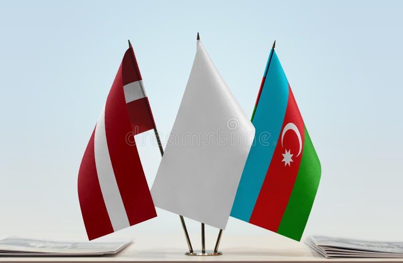 Banderas de Letonia y de Azerbaijan fotos de archivo libres de regalías