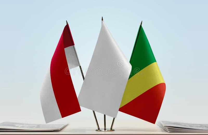 Banderas de Mónaco y del República del Congo fotografía de archivo libre de regalías
