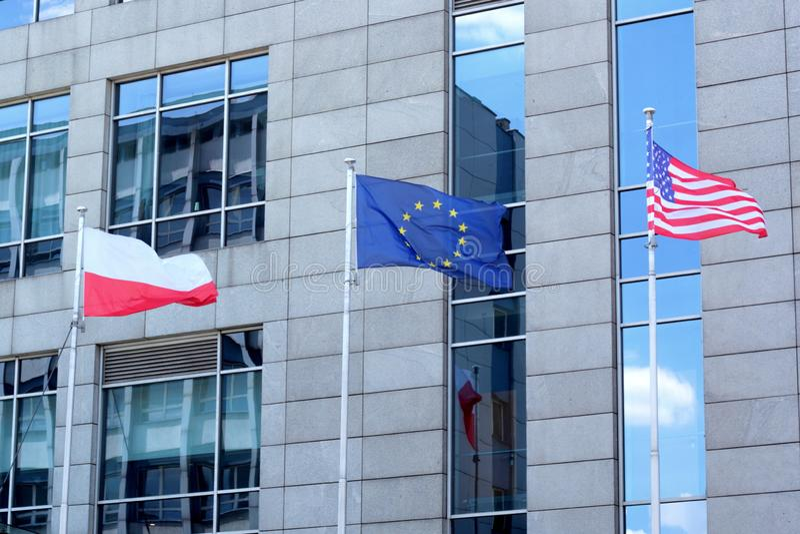 Banderas de Polonia, de la UE y de los E.E.U.U. fotos de archivo