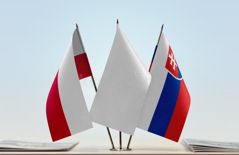 Banderas de Polonia y de Eslovaquia fotografía de archivo libre de regalías