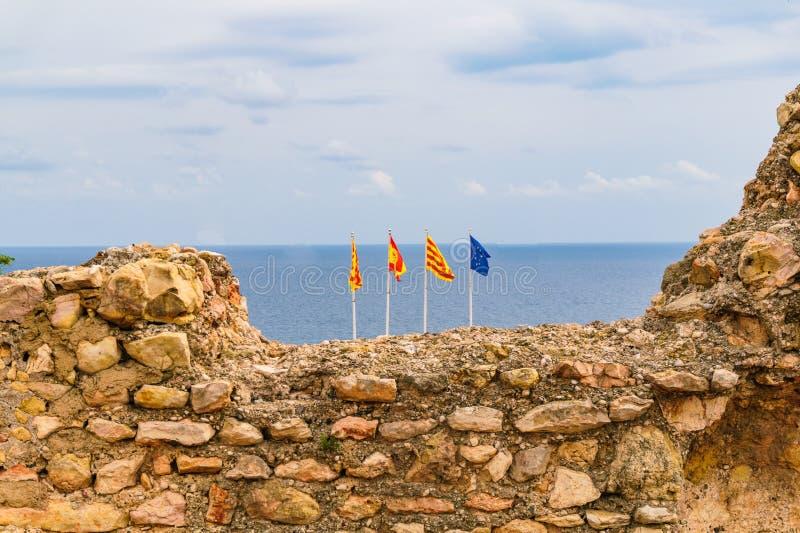 Banderas de un catalan, bandera española y la bandera europea imagenes de archivo