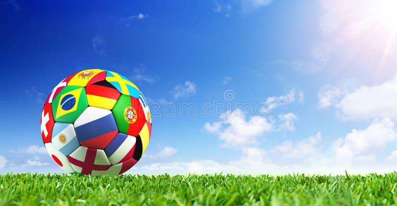 Banderas del balón de fútbol en hierba fotos de archivo