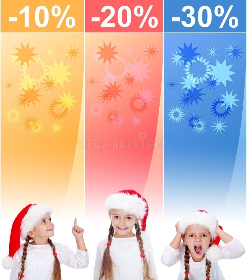 Banderas locas de la venta de la Navidad con la niña foto de archivo
