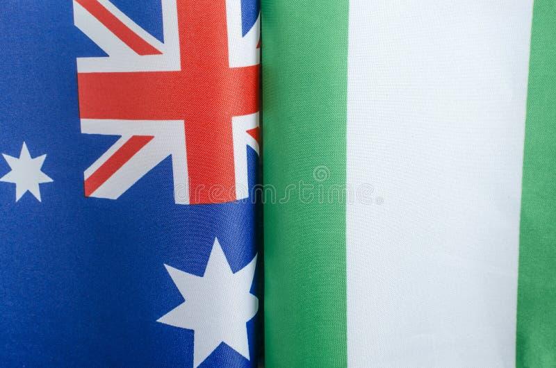 Banderas nacionales de Australia y de Nigeria foto de archivo libre de regalías