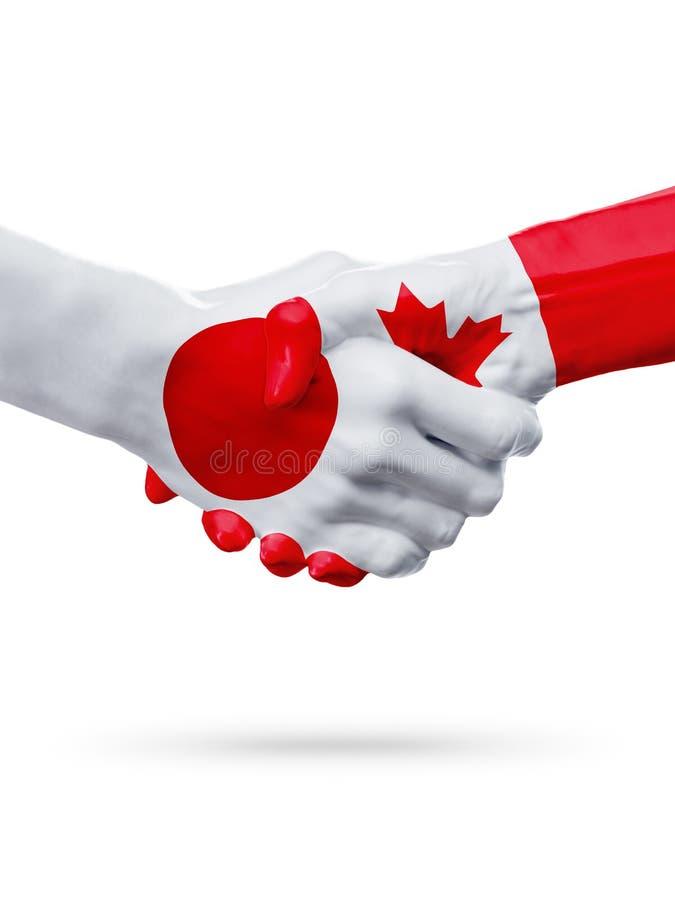 Banderas países de Japón, Canadá, concepto del apretón de manos de la amistad de la sociedad fotos de archivo