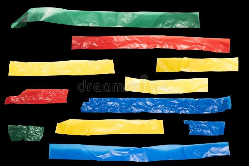 Bandes de bande colorée sur un fond noir pour le tiers inférieur images libres de droits