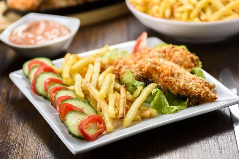 Bandes et fritures de poulet image libre de droits