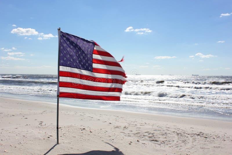 Bandiera americana alla spiaggia fotografia stock libera da diritti