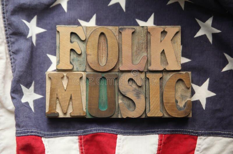 Bandiera americana con le parole di musica folk immagini stock libere da diritti