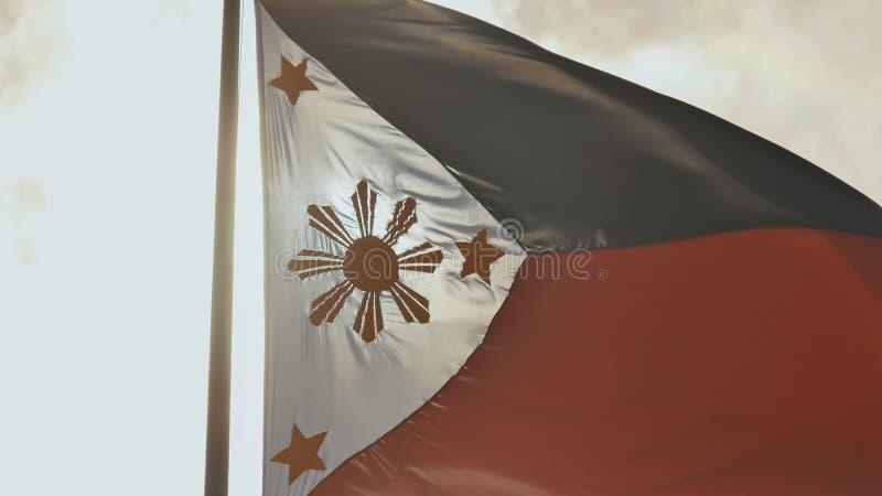 Bandiera bicolore volante delle Filippine con il sole dorato centrale che rappresenta le province e le stelle le isole immagine stock libera da diritti