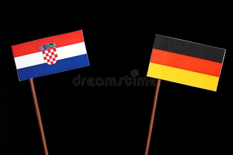 Bandiera croata con la bandiera tedesca sul nero fotografia stock libera da diritti