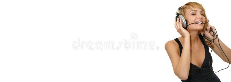Bandiera d'ascolto di Web di musica della ragazza fotografia stock libera da diritti