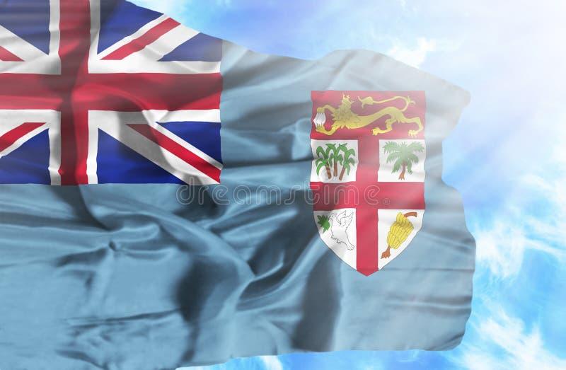 Bandiera d'ondeggiamento di Figi contro cielo blu con i raggi di sole illustrazione di stock