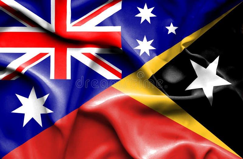 Bandiera d'ondeggiamento di Timor orientale e dell'Australia royalty illustrazione gratis