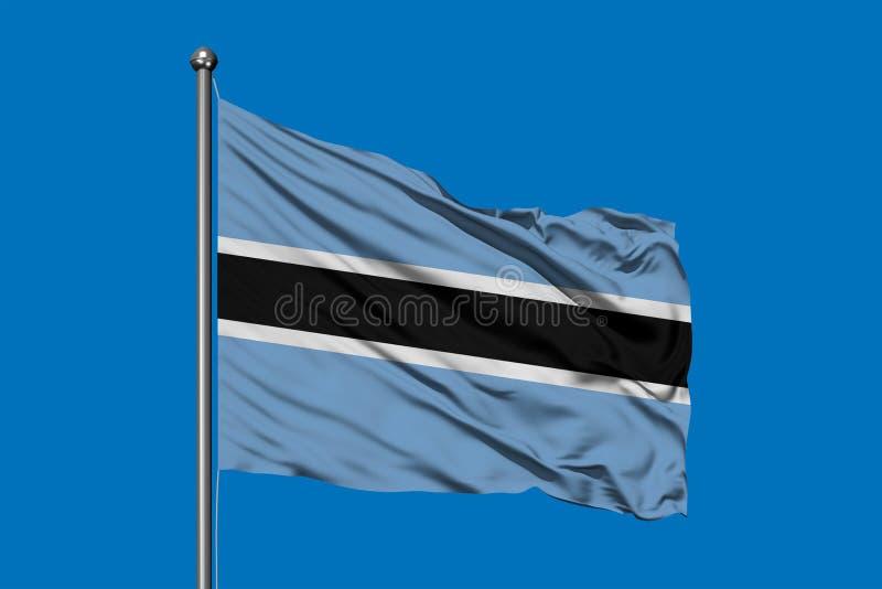 Bandiera del Botswana che ondeggia nel vento contro il cielo blu profondo Bandiera di Botswanan fotografia stock libera da diritti