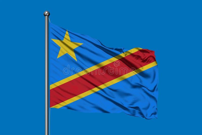 Bandiera del Congo che ondeggia nel vento contro il cielo blu profondo Bandiera congolese fotografie stock