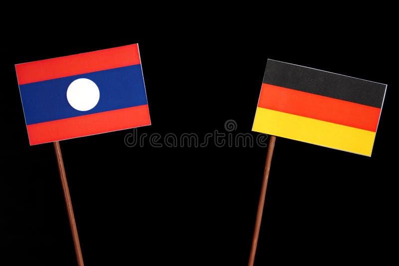 Bandiera del Laos con la bandiera tedesca sul nero fotografia stock libera da diritti