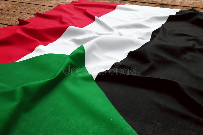 Bandiera del Sudan su un fondo di legno dello scrittorio Vista superiore della bandiera sudanese di seta fotografie stock libere da diritti