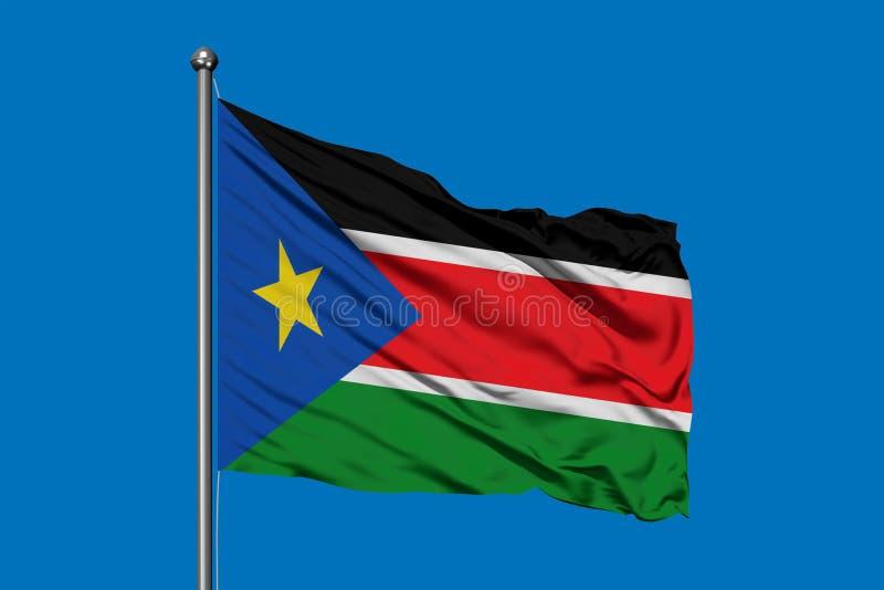 Bandiera del Sudan del sud che ondeggia nel vento contro il cielo blu profondo fotografia stock