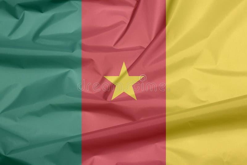 Bandiera del tessuto del Camerun Piega del fondo camerunese della bandiera fotografia stock