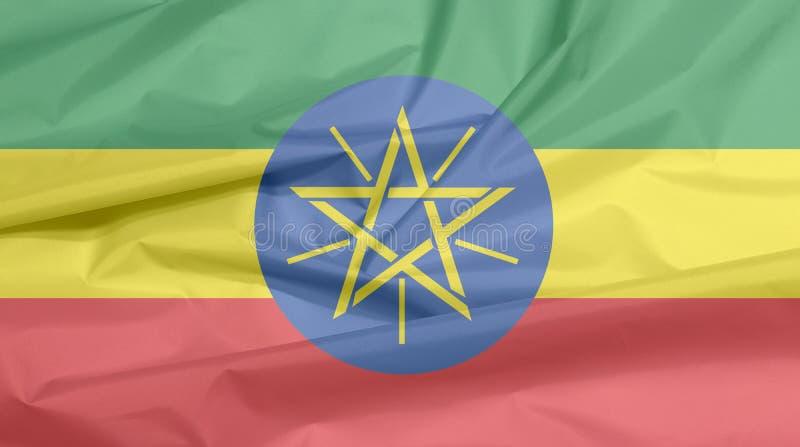 Bandiera del tessuto dell'Etiopia Piega del fondo etiopico della bandiera fotografie stock libere da diritti
