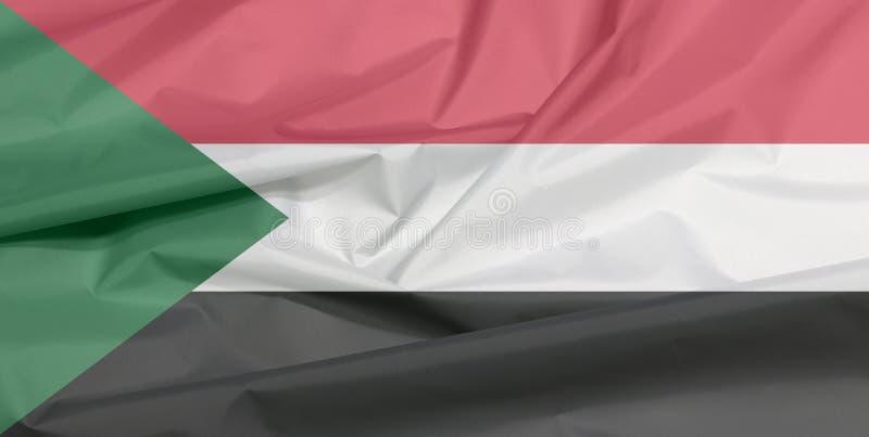 Bandiera del tessuto del Sudan Piega del fondo della bandiera del sudanese immagine stock libera da diritti