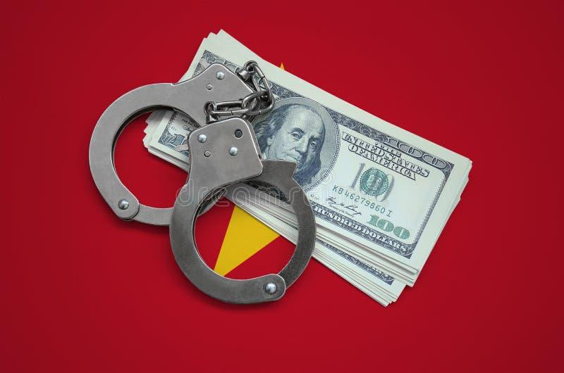 Bandiera del Vietnam con le manette e un pacco dei dollari Corruzione di valuta nel paese crimini finanziari immagine stock