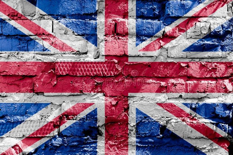 Bandiera della Gran Bretagna dipinta su un muro di mattoni Bandierina del Regno Unito Priorità bassa astratta strutturata fotografia stock libera da diritti