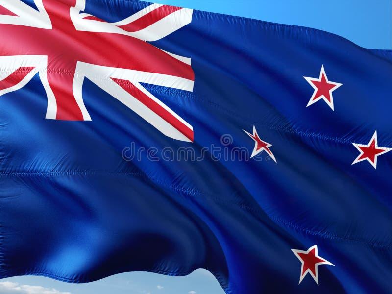Bandiera della Nuova Zelanda che ondeggia nel vento contro il cielo blu profondo Tessuto di alta qualit? fotografia stock