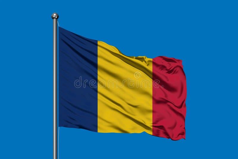 Bandiera della Repubblica del Chad che ondeggia nel vento contro il cielo blu profondo Bandiera del Chad royalty illustrazione gratis