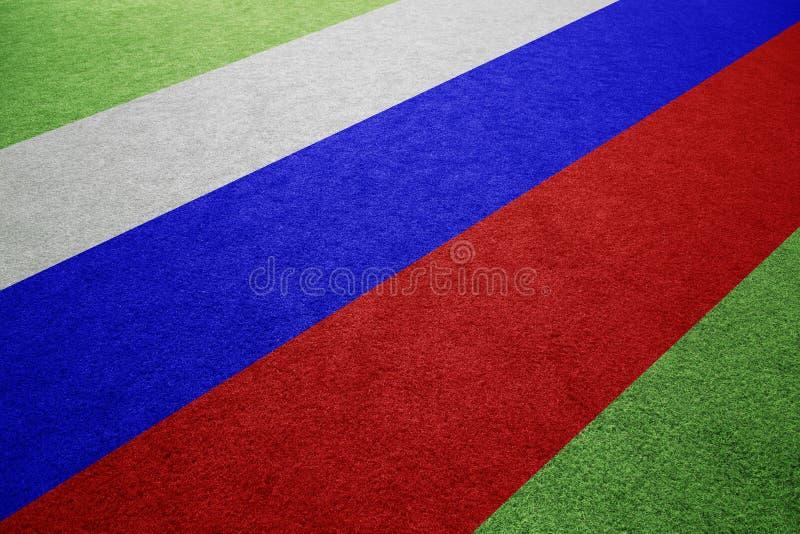 Bandiera della Russia sul fondo del campo di calcio fotografie stock