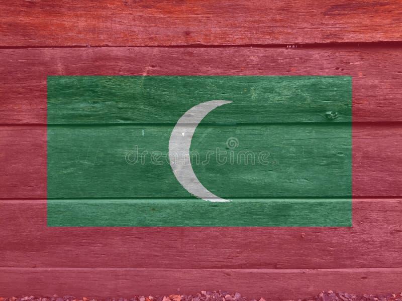 Bandiera delle Maldive sul fondo di legno della parete Struttura della bandiera delle Maldive di lerciume fotografia stock
