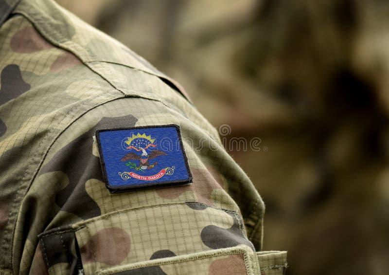 Bandiera dello Stato del North Dakota sull'uniforme militare Stati Uniti USA, esercito, soldati Collage immagine stock libera da diritti