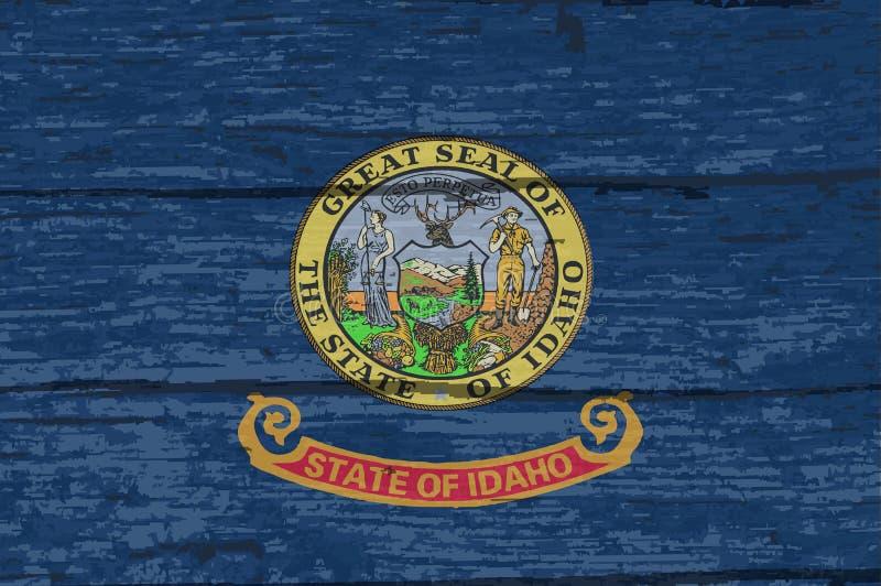 Bandiera dello stato dell'Idaho su vecchio legname illustrazione vettoriale
