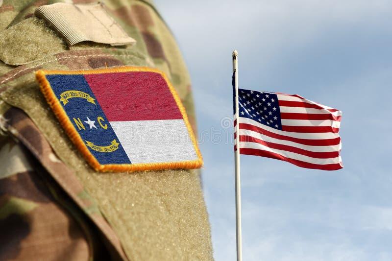 Bandiera dello Stato della Carolina del Nord sull'uniforme militare Stati Uniti USA, esercito, soldati Collage immagini stock libere da diritti