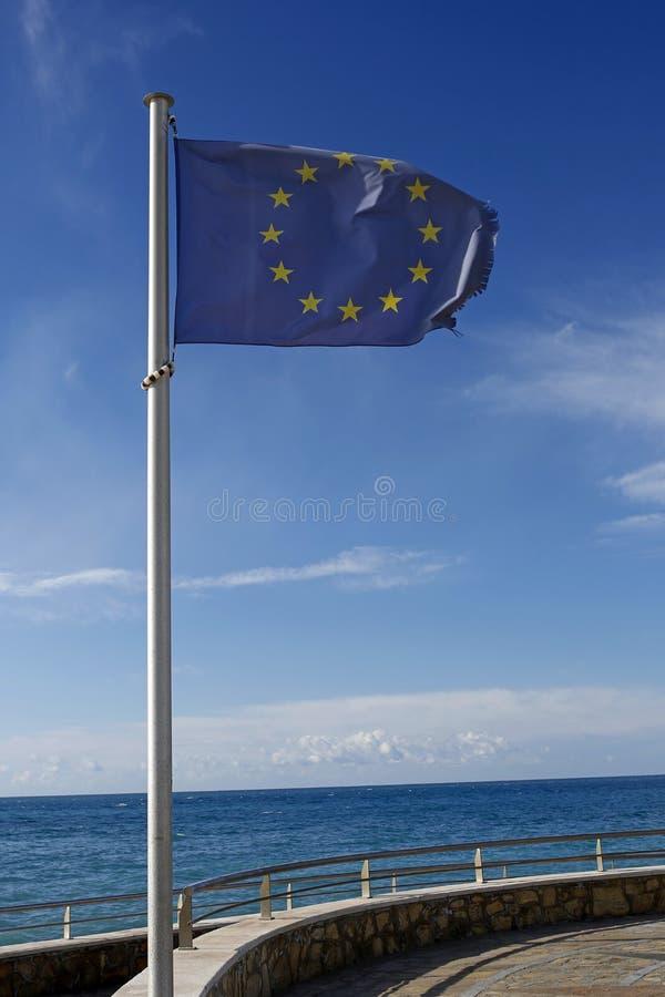 Bandiera di Unione Europea sulla spiaggia fotografia stock
