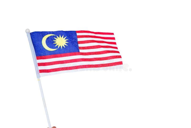Bandiera malese della tenuta umana della mano fotografia stock libera da diritti
