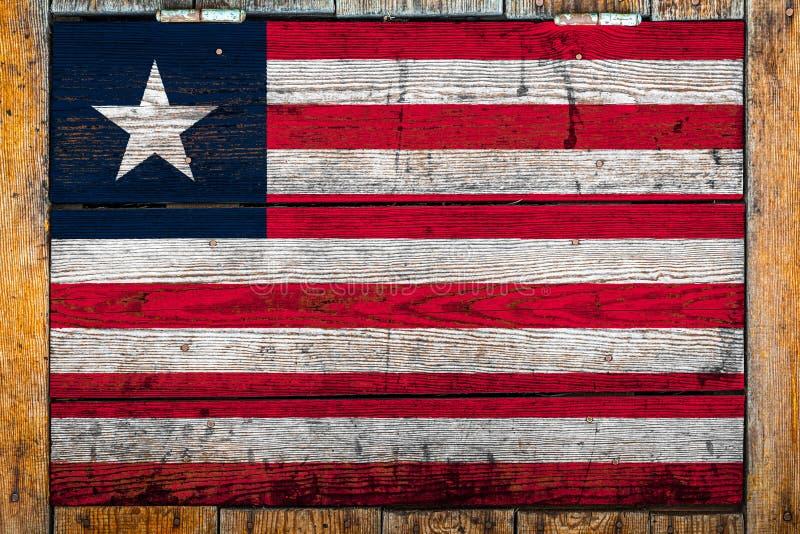 Bandiera nazionale su un fondo di legno della parete fotografia stock