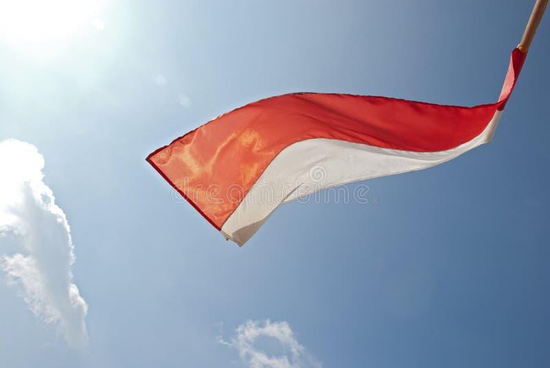 Bandiera nel vento in sole immagini stock libere da diritti